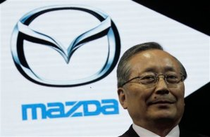 Mazda Motor Co. President and CEO Takashi Yamanouchi poses for photographers at the Shanghai International Automobile Industry Exhibition (AUTO Shanghai) media day in Shanghai, China Saturday, April 20, 2013. (AP Photo/Eugene Hoshiko)