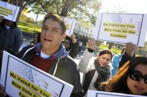 Members of immigration rights organizations, including Casa in Action and Maryland Dream Act, demonstrate Nov. 8, 2012, in front of the White House. AP