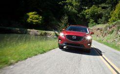 image.automobilemag.com*f*reviews*driven*1204_ford_escape_vs_honda_cr_v_vs_mazda_cx_5_comparison*41348703 w799 h499 cr1 ar0*2013-Mazda-CX-5-Grand-Touring-FWD-front-view
