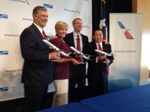 American Airlines CEO Tom Horton, second from right, handed out airplane models to, from left, Dallas Mayor Mike Rawlings, Fort Worth Mayor Betsy Price and DFW Airport board chairman Robert Hsueh after the carrier announced it would launch Shanghai and Hong Kong service from Dallas/Fort Worth. (Terry Maxon/DMN)