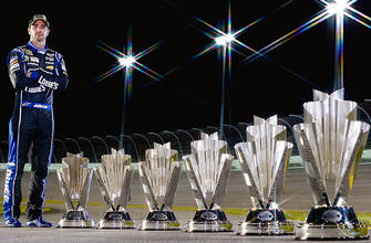NASCAR-Jimmie-Johnson-Poses-with-Trophies-