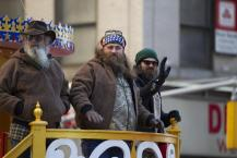 The cast of Duck Dynasty waves at the crowd during the Macy's Thanksgiving Day Parade, Thursday, Nov. 28, 2013, in New York.