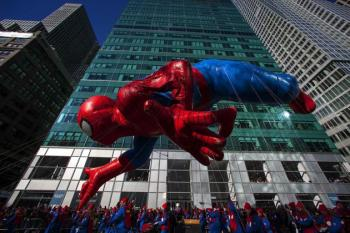 A Spiderman balloon floats down Sixth Avenue during the 87th Macy's Thanksgiving Day Parade in New York November 28, 2013. REUTERS/Eric Thayer