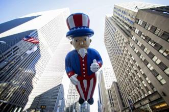An Uncle Sam balloon floats down Sixth Avenue during the 87th Macy's Thanksgiving Day Parade in New York November 28, 2013. REUTERS/Eric Thayer