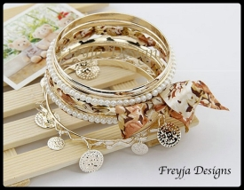 Price $ 58.00 Fashion Bracelets Diameter: 8.5cm Style: Trendy Metals Type: Zinc Alloy Shape\pattern: Plant Material: Metal