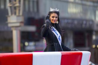 Miss America Nina Davuluri waves at the crowd during the Macy's Thanksgiving Day Parade, Thursday, Nov. 28, 2013, in New York.