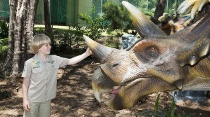 Robert Irwin with a triceratops at Palmersaurus. Photo: Glenn Hunt