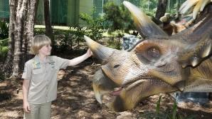 Robert Irwin with a triceratops at Palmersaurus. Photo: Glenn Hunt
