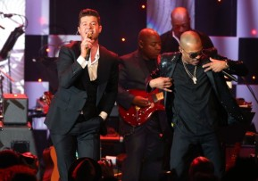 Robin Thicke (L) and T.I...